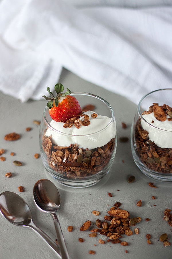This quick & easy chocolate granola is the perfect breakfast for busy people on the go! Jam packed with seeds, nuts and of course, chocolate! www.thehomecookskitchen.com #granola #breakfastidea #quickbreakfast
