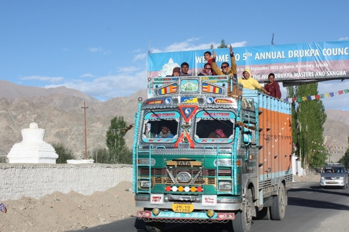 people riding in a colorful truck in northern india