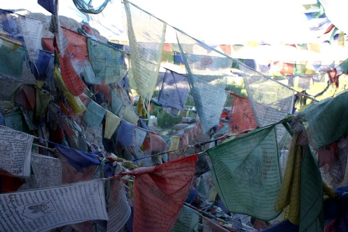 prayer flags hanging on a mountain in india