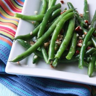 green beans with hazelnut garlic butter www.thehomecookskitchen.com perfect for a winter side dish, crunchy and oh so buttery.