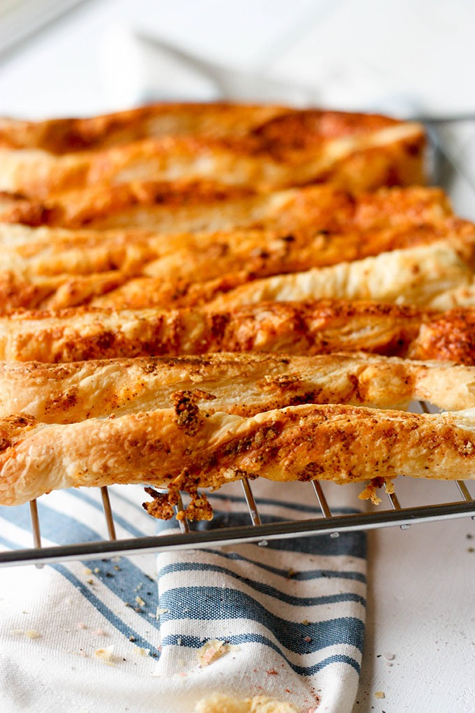 wire rack filled with puff pastry cheese straws