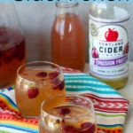 pinterest graphic - two glasses of passionfruit cider punch on a colourful napkin with blue header and text