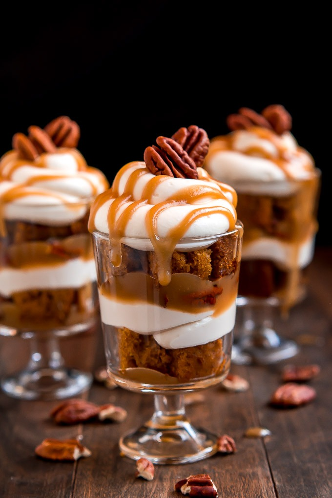 caramel pecan pumpkin cheesecake on wooden board