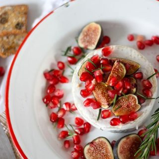 overhead oven baked brie on white and red enamel plate