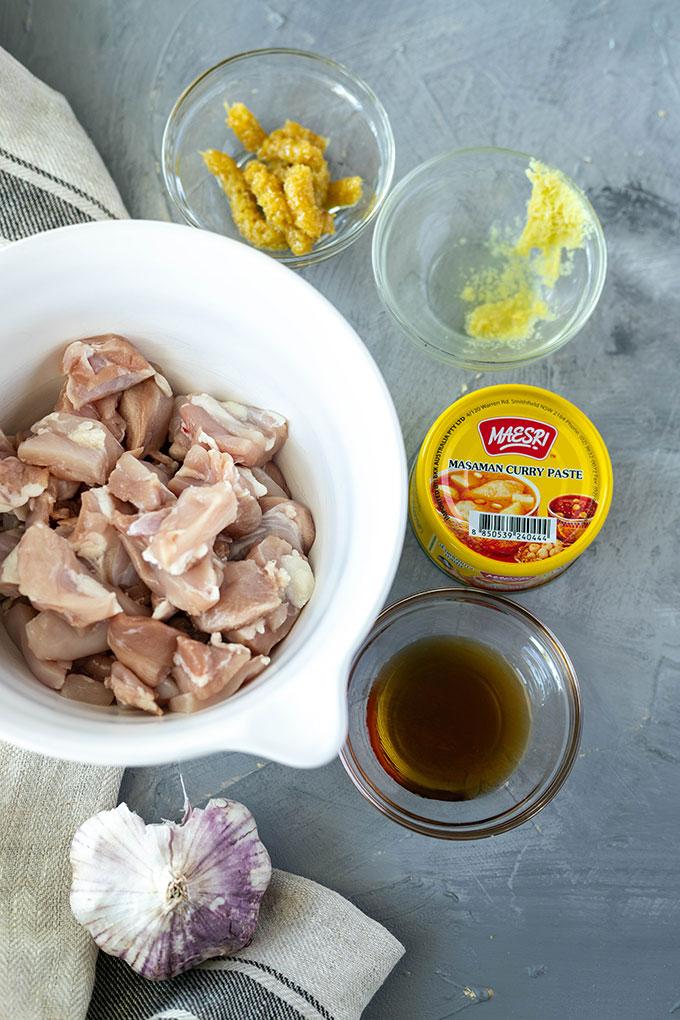 chicken massaman curry ingredients - chicken, ginger, lemongrass, curry paste, fish sauce and garlic