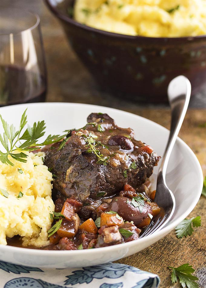 French short ribs with mash in white bowl