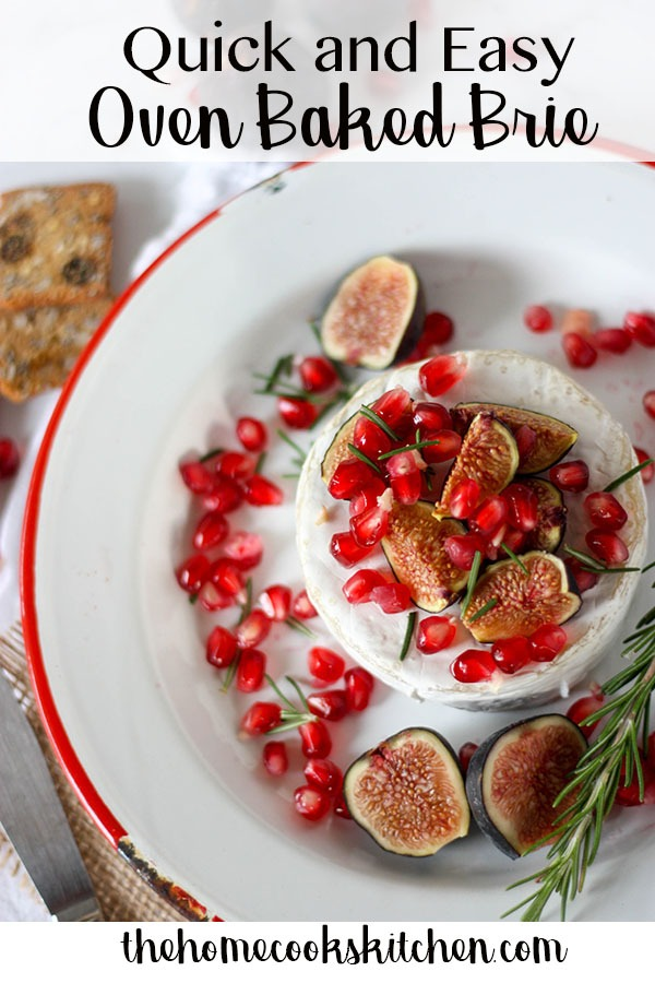 This oven baked brie with fig & pomegranate will be your new festive favourite! This appetzier is simple, quick and so delicious for a festive feast! Great to serve for friends over the Thanksgiving and Christmas period, this appetizer comes together in less than 20 minutes #bakedbrie #ovenbakedbrie #bakedbrierecipe