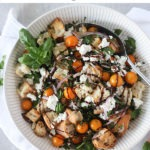 pinterest graphic - bowl of panzanella salad with 'panzanella salad recipe' text on white banner top of image