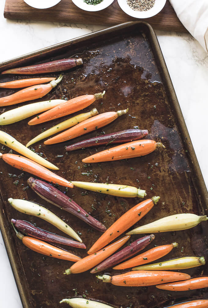 multicolored carrots on a baking tray