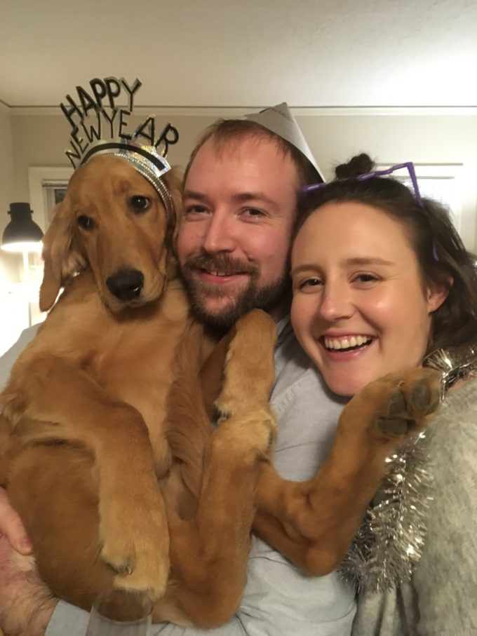 me and my husband holding our golden retriever puppy for new years eve