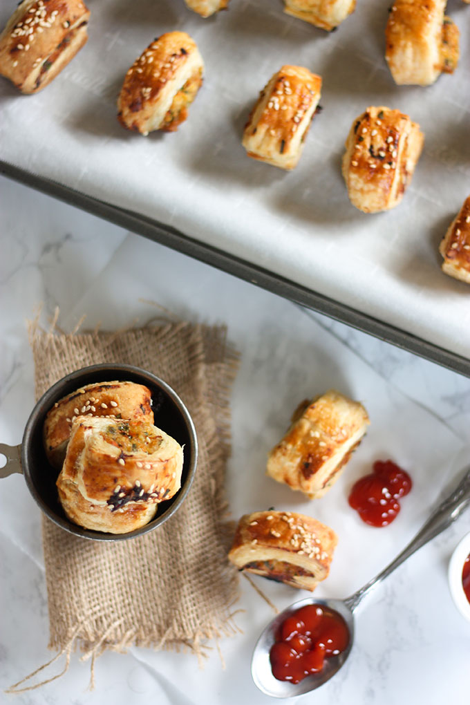 tray of thai sausage rolls top of image, sausage rolls in antique metal cup in bottom