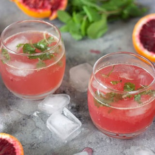 This blood orange ginger cocktail is perfect for the changing weather! A light, refreshing cocktail, brought to life with a beautiful ginger-mint simple syrup! #citrus #cocktails #vodka #bloodorangecocktail
