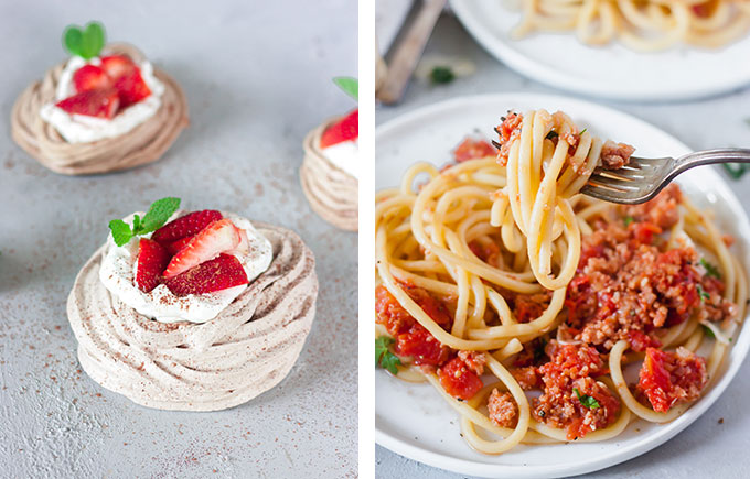 chocolate meringue with strawberries and cream on left hand side, bucatini all'amatriciana on white place on right hand side
