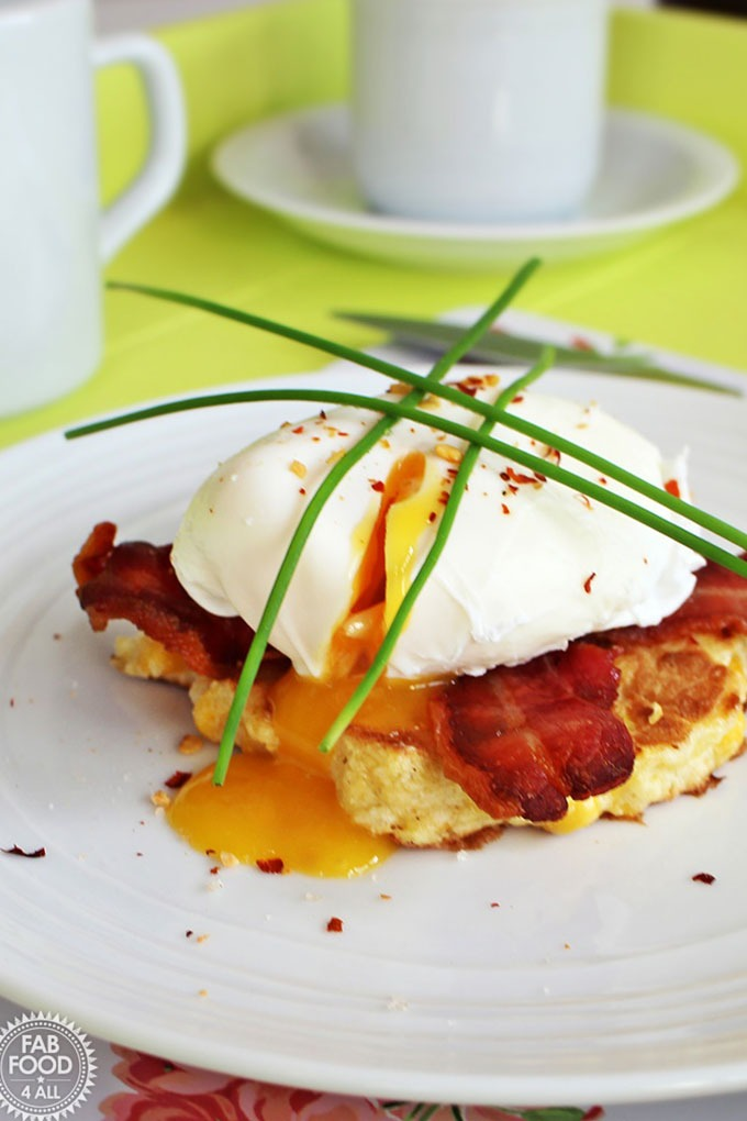 poached egg on a bacon hashbrown with chives