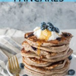 stack of blueberry kefir pancakes on white plate with blue banner and text for Pinterest