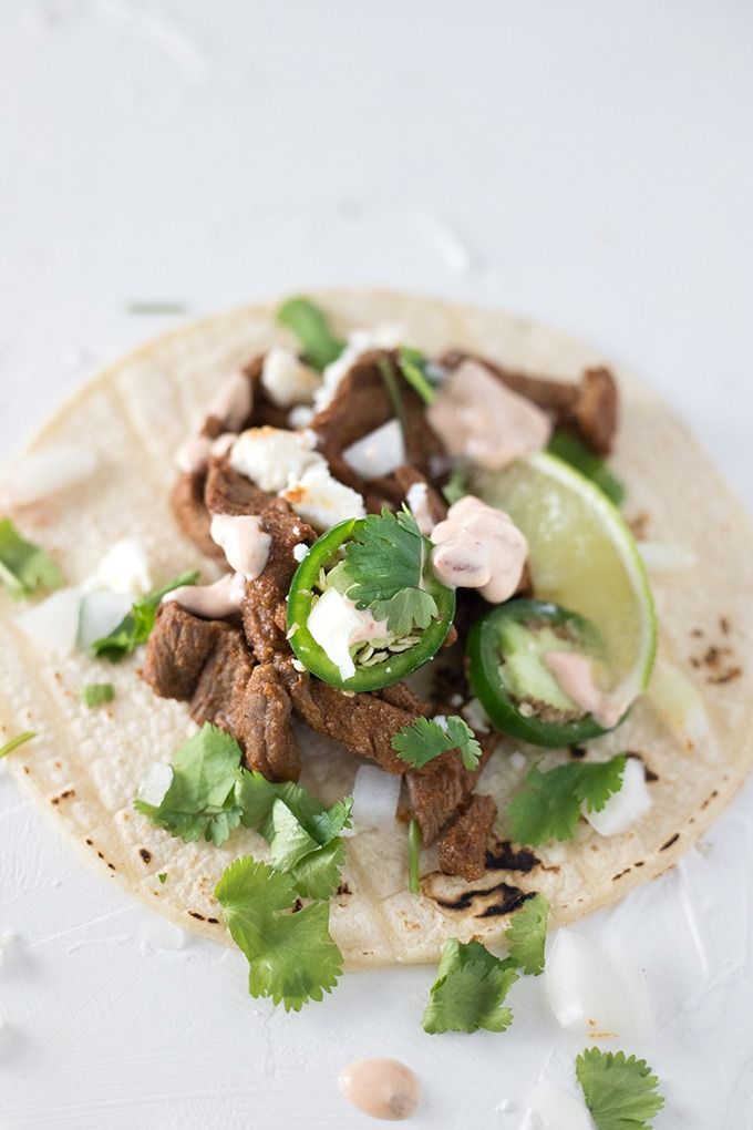 close up single taco with jalapeno, lime and chipotle dressing