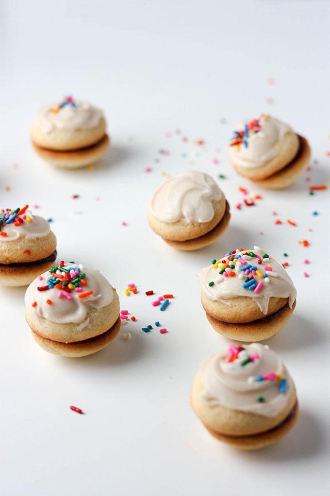 seven vanilla sandwich cookies on white board