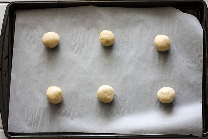tray of cookie dough, 6 vanilla sandwich cookie dough rolled into small balls