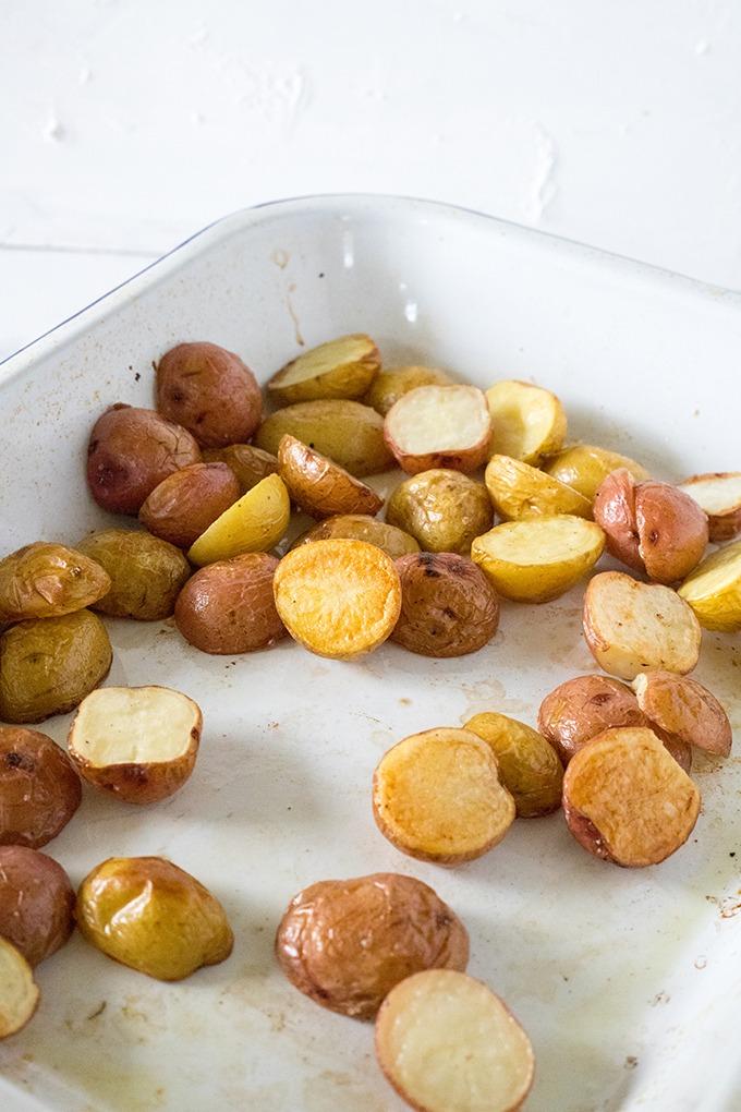 crispy roasted potatoes in a white enamel pan