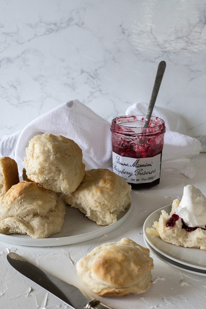 plate of lemonade scones in front of jam jar