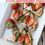 strawberry bruschetta on white plate with text on top of image for Pinterest