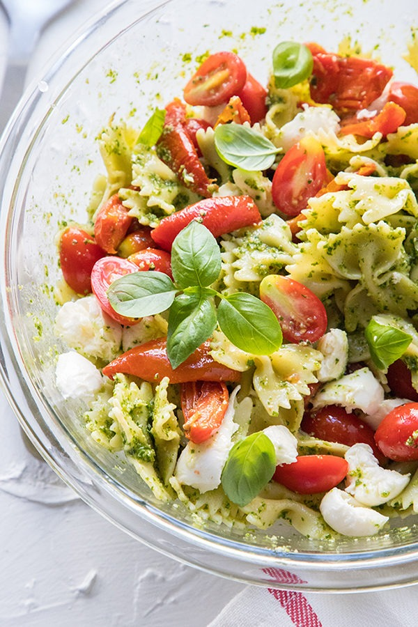 caprese pasta salad in a large glass salad bowl