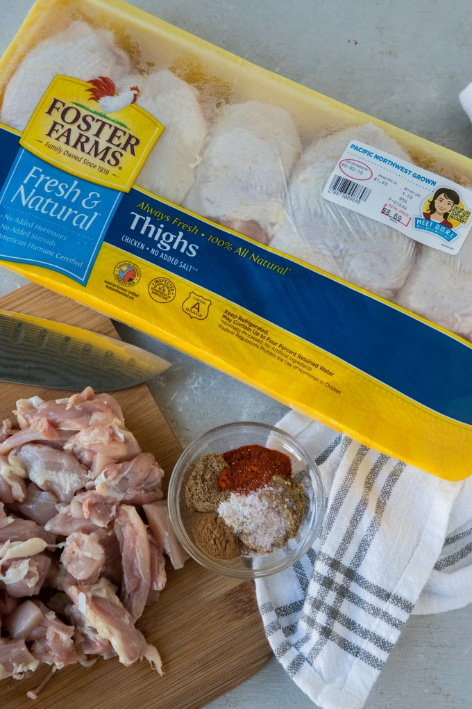 chicken on board with spice mix and packet of foster farms chicken thighs