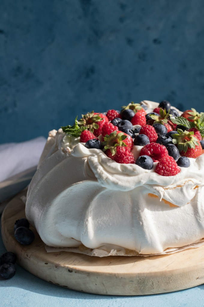 pavlova on an antique wooden board