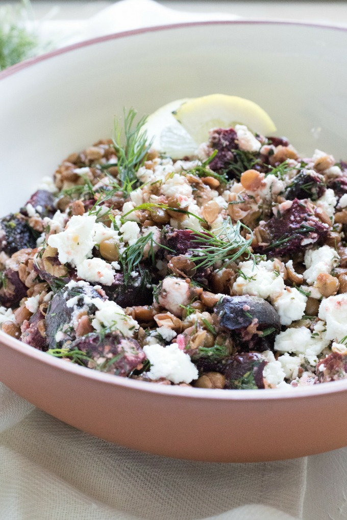 feta lentil salad in brown and white bowl