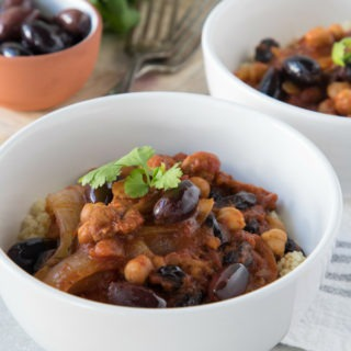 moroccan chicken stew in a white bowl