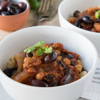 moroccan chicken stew in white bowl