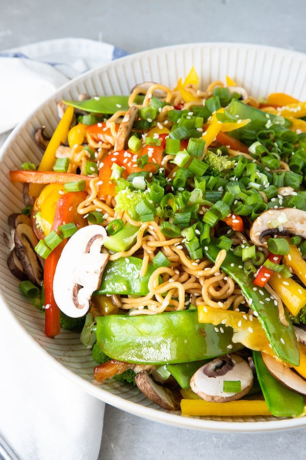 asian noodle salad in large white bowl