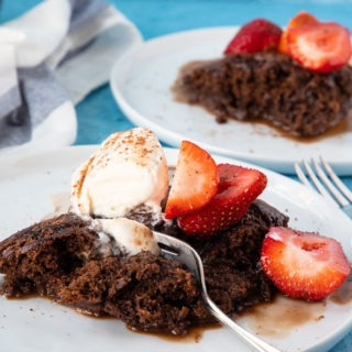 chocolate self saucing pudding on white plate