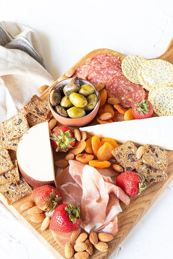 meat and cheese board featured on white background