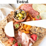 Pinterest graphic - meat and cheese board with text on white banner at top of image