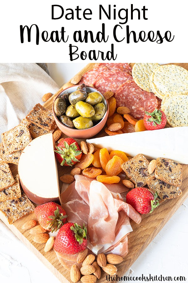 Date Night Meat and Cheese Board, aka the perfect excuse to crack open the wine, nibble on some munchies and have a cheap and easy date night at home! I've perfected my favourite meat and cheese board for you today, providing tips and tricks on how to create a beautiful, simple elegant charcuterie at home with minimal fuss. #charcuterie #meatandcheeseboard #datenight