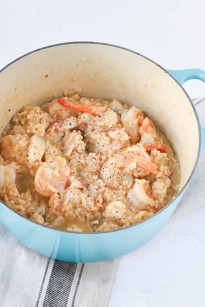finished prawn risotto in blue dutch oven