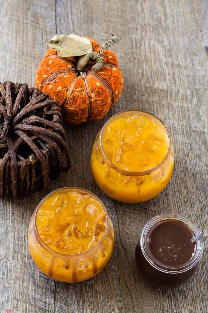 15 fall cocktails - two pumpkin apple punch glasses on wooden board