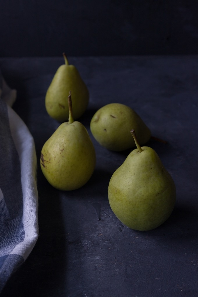 four pears on black board