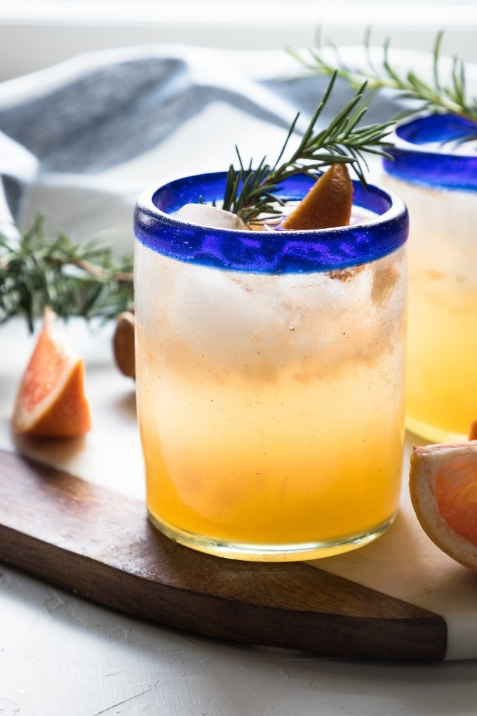 15 fall cocktails - grapefruit gin cocktail in blue and clear glass