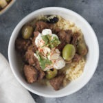 close up white bowl of moroccan lamb tagine with couscous