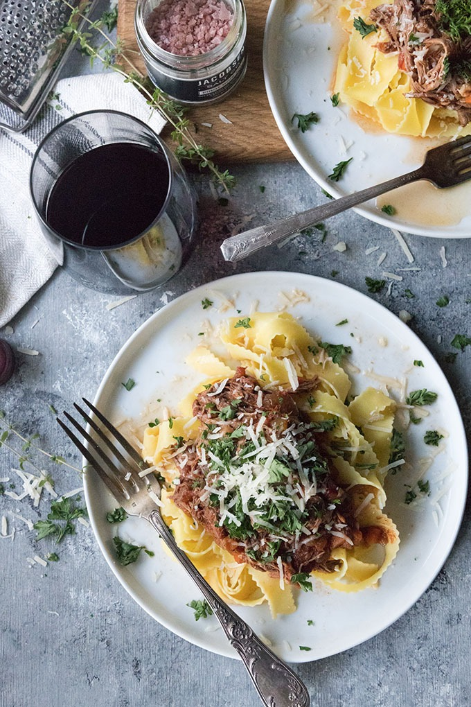 slow cooker beef ragu with pappardelle on white plate with antique spoon
