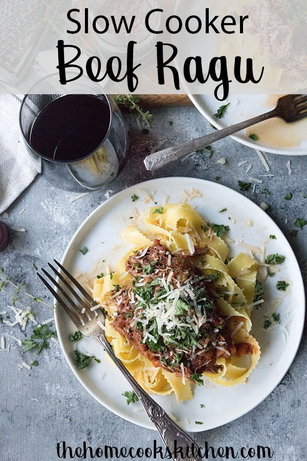 Slow Cooker Beef Ragu - slow cooked to perfection, beef that is falling apart and a thicktomato sauce! Served with fresh pappardelle and herbs. This beef ragu is perfect for a special occasion, date night, fall dinner party or everyday family meal! #beefragu #ragu #slowcookerbeefragu #slowcookedbeef #slowcookerbeef