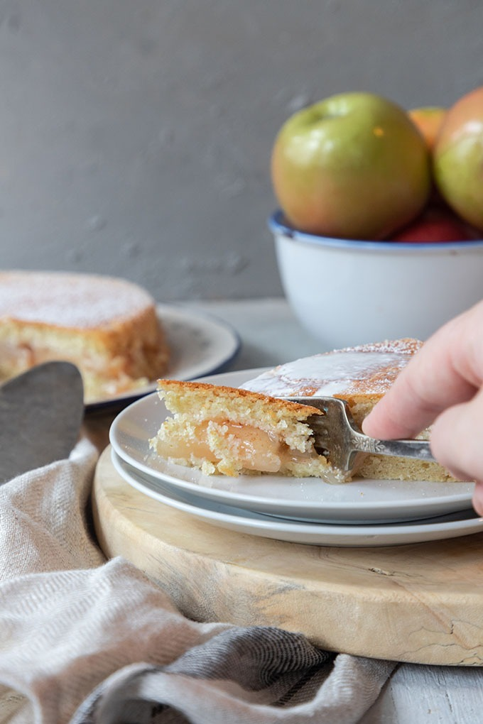 hand with fork digging into apple shortcake