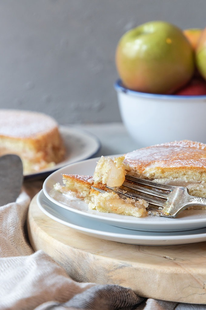 apple cake with fork on white plate