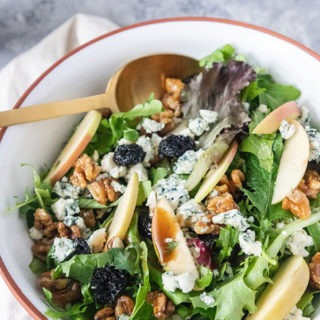 fall harvest salad in brown and white bowl