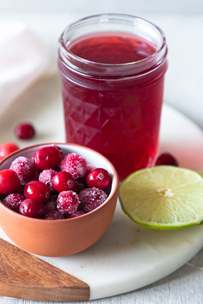 cranberries, cranberry juice and lime on marble board