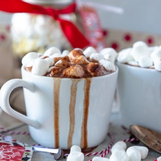 hot chocolate overflowing in white mug