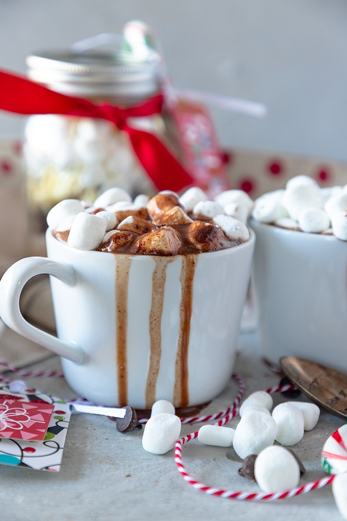 hot chocolate overflowing in white mug