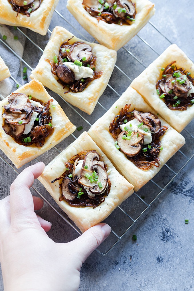 hand reaching to grab mushroom tart